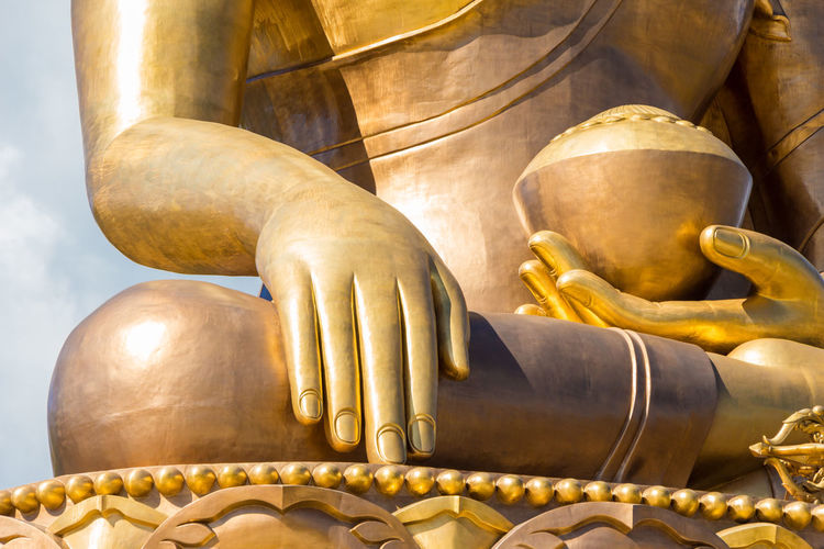 Low Angle View Of Golden Buddha Statue