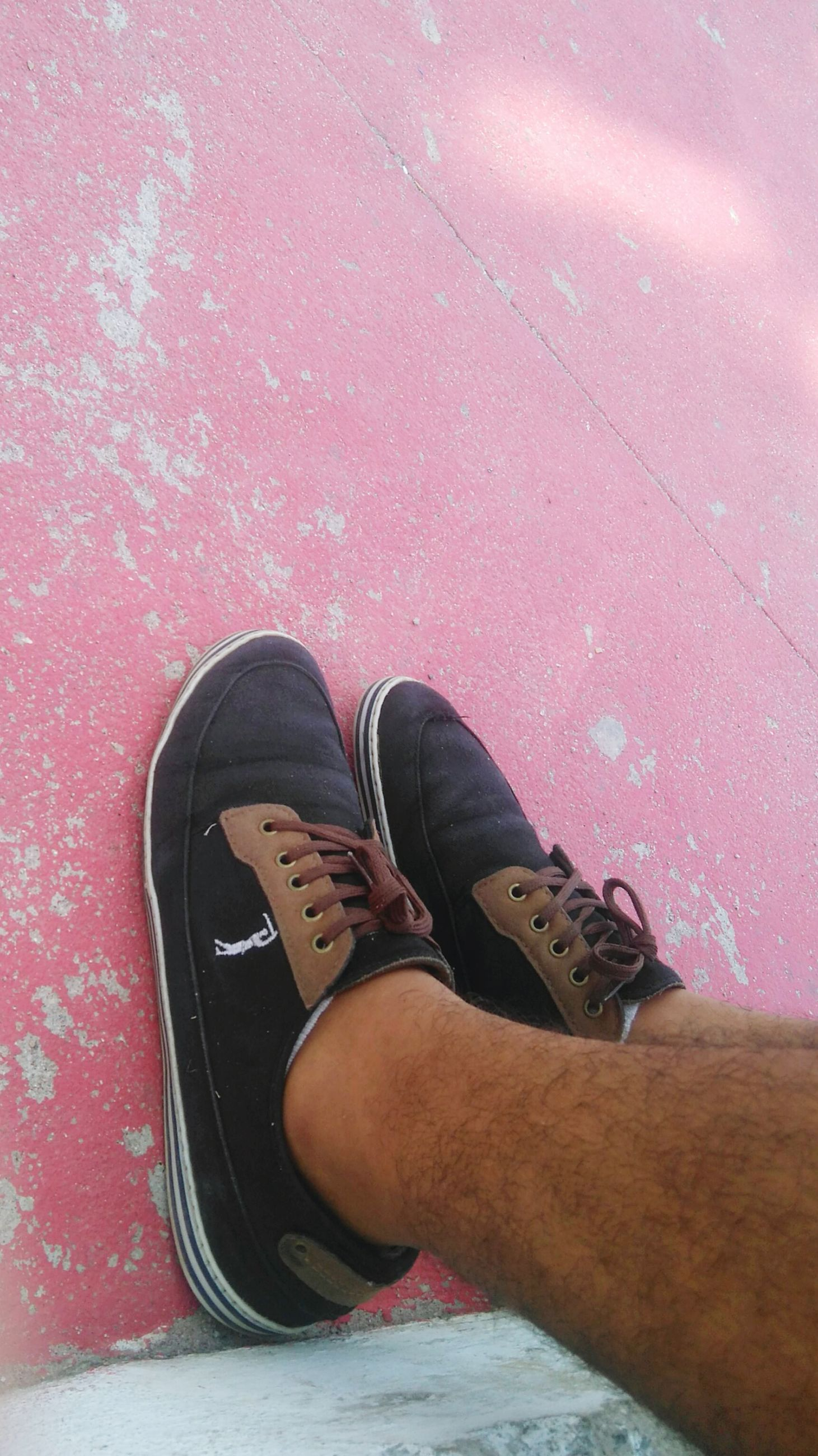 low section, shoe, person, footwear, personal perspective, human foot, jeans, street, footpath, day, pink color