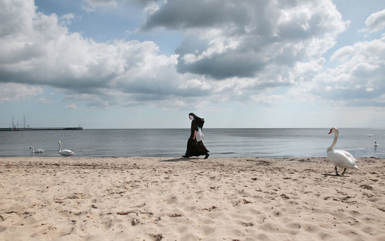 BLACK SWAN Black Dress Black Swan Faith Funny Moments Poland Sister Beach Beauty In Nature Belief Blackandwhite Clouds Full Length Horizon Over Water Nun One Person Outdoors Polish Real People Religion Scenic View Sea Sopot Strange Strangers In Transit Walking By