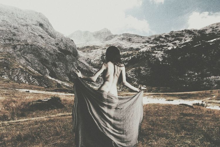 Woman standing on mountain landscape