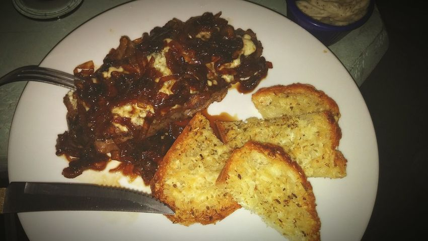 Rib eye with sweet caramelized onions, a rich balsamic reduction, and melted gorgonzola....and garlic cheesy bread!