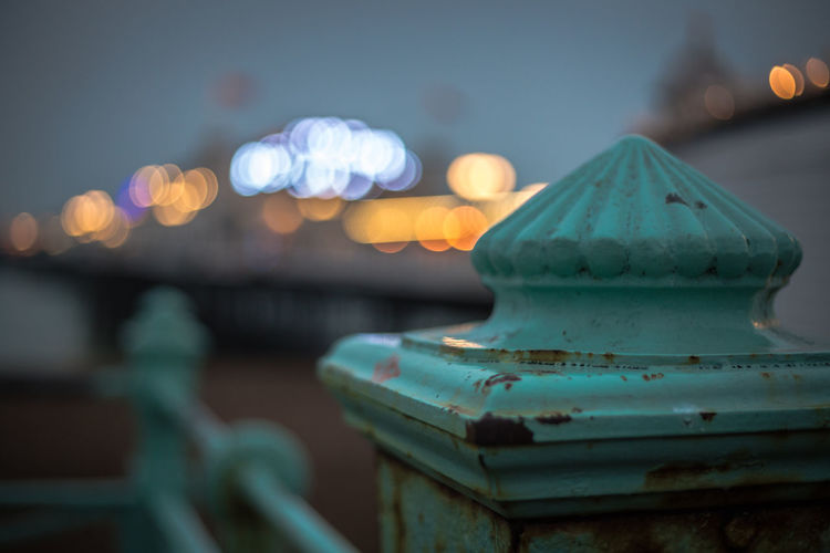 Focus On Foreground No People Close-up Metal Illuminated Outdoors Night Lighting Equipment Nature Blue Railing Sky Shape Water Dusk Old Wood - Material Design Security Bokeh Bokeh Photography Brett Kotch Brighton Brighton Beach Selective Focus