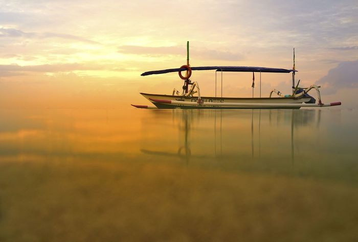 A traditional boat in Bali. Bali Bali, Indonesia Sanur Adventure Airplane Cloud - Sky Day Nature Nautical Vessel No People Outdoors Scenics Sea Sky Sunset Tourism Transportation Travel Travel Destinations Water