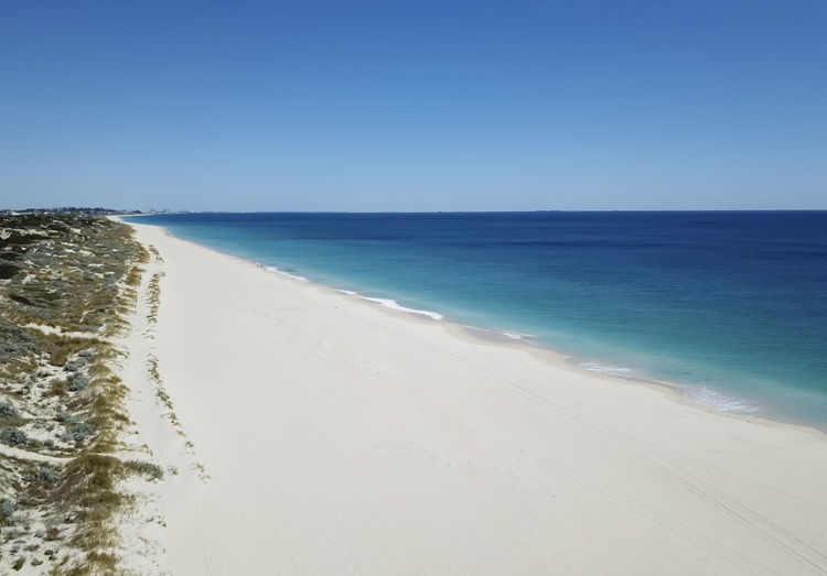 Beautiful white sand beach and ocean Australia Baywatch Drone  Exercise Holiday Indian Ocean Indiana Tea House Scarborough Western Australia Aerial Beach Beauty In Nature Blue Blue Water City Beach Clear Sky Coast Cottesloe Day Destination Horizon Over Water Landscape Nature No People Outdoors Sand Scenics Sea Sky Swanbourne Tranquil Scene Tranquility Turquoise Water Water Wave White Pristine Beach