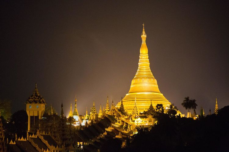 Shwedagon Pagoda at night, Yangon, Myanmar Yangon Architecture Belief Buddhism Building Building Exterior Built Structure Gold Colored Illuminated Myanmar Night No People Outdoors Place Of Worship Religion Spire  Spirituality Tourism Travel Destinations