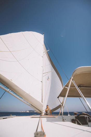 Lost In The Landscape Blue Clear Sky Day Mode Of Transport Nautical Vessel One Person Outdoors People Sailboat Sailing Sea Sky Transportation Travel Yacht Yachting