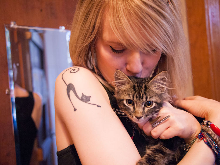 Hug Woman Animal Themes Beautiful Woman Blond Hair Cat Close-up Day Domestic Animals Domestic Cat Human Hand Indoors  Mammal One Animal One Person People Pets Real People Tattoo