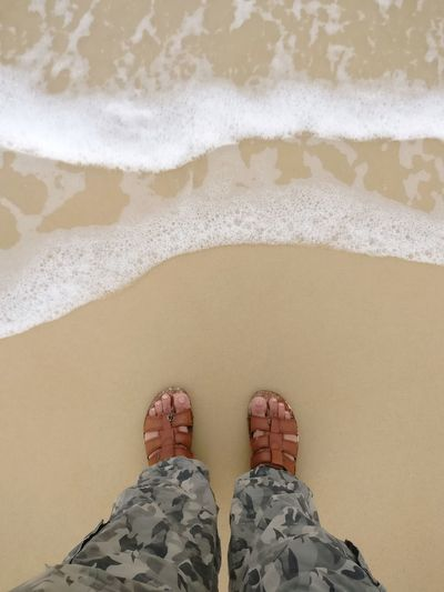 Beach time. Personal Perspective View From Above Beach Time Beach View Foam Army Style Camouflage Clothing Sandy Beach Holidays Vacation Travel Travel And Leisure Leisure India Low Section Water Wave Sea Beach Sand Standing Human Leg Summer Flip-flop Pair Footwear Foot Slipper  Shore Leg