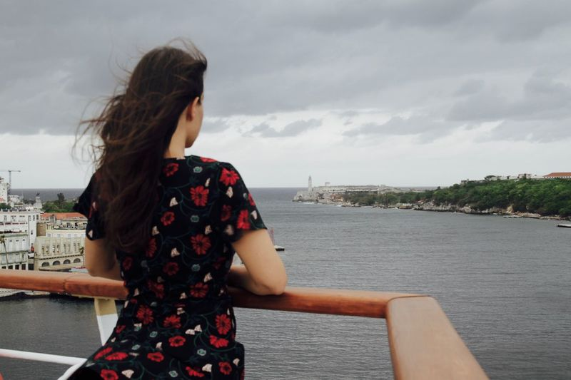 Woman standing on cruise with havana in background