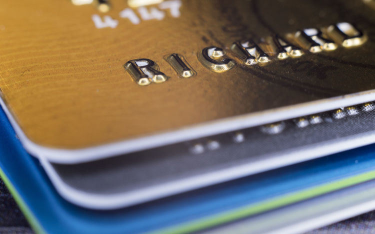 Macro Corner view Credit Cards Banking Banking Business Buying Cash Close Up Commerce Credit Cards Crime Cyber Debt Firewall Fraud Identity Industry Macro Microchip Money Numbers Online  Shopping Spending Spending Money Tech Technology Theft