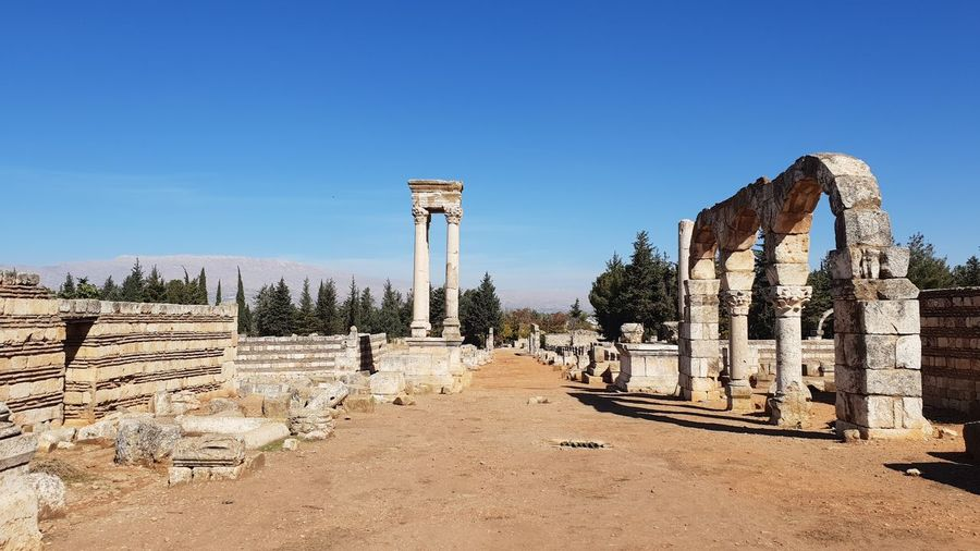 Ruins of temple against clear blue sky