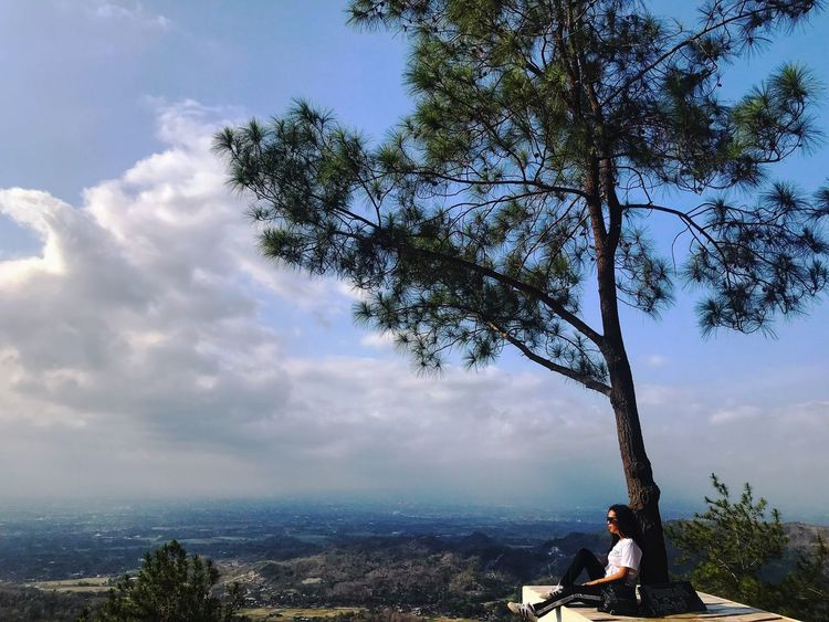 Puncak becici #journey #Nature  Indonesian EyeEm Best Shots EyeEmNewHere EyeEm Masterclass JustMe Alone Time #likeforlike #likemyphoto #qlikemyphotos #like4like #likemypic #likeback #ilikeback #10likes #50likes #100likes #20likes #likere Tree Plant Leisure Activity Real People Cloud - Sky Sky One Person Lifestyles Nature Sitting Beauty In Nature Day Water Women Outdoors Land Growth Tranquility Adult
