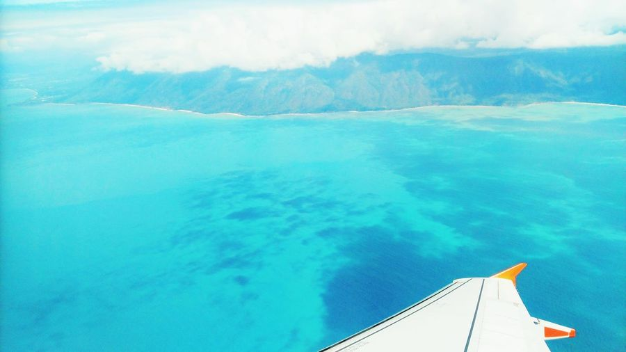 Blue Vacations Water Travel Sky Sea Outdoors Cloud - Sky Tropical Climate Nature Travel Destinations Scenics Tranquil Scene No People Flightview Airplane Airplane Wing Day Beauty In Nature Mountain Nautical Vessel One Person Kristinejensson Viewpoint Blue Water