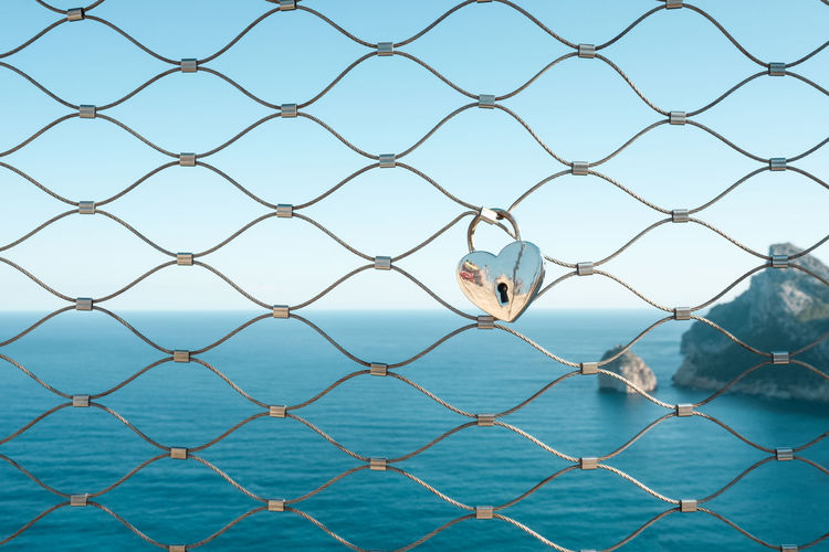 Bonding Chainlink Fence Fence Heart Heart Shape Horizon Over Water Key Lock Love Mediterranean  Mediterranean Sea Nature Ocean Outdoors Protection Relationship Rock Rock - Object Sea Sea And Sky Sea View Seascape Sky Symbol Vacations