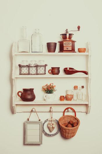 View of bottles on shelf against white background