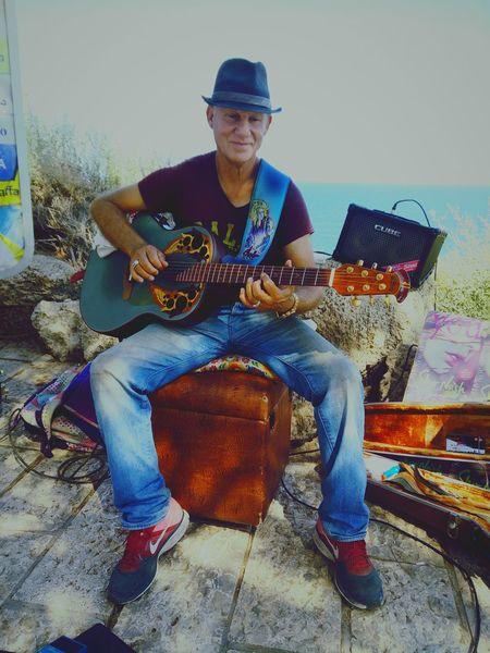 Music Street Musician Israel Jaffa Street Photo Live Music Guitarist Playing Guitar Sea And Sky Sunny Day