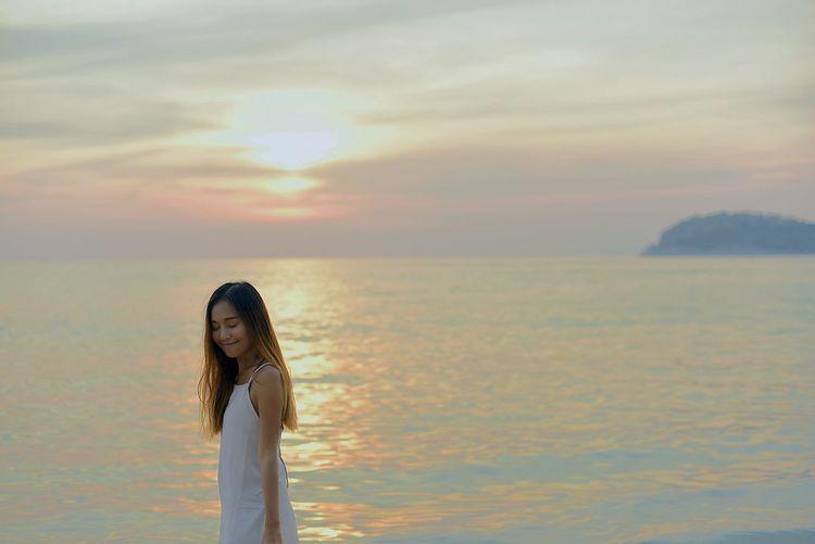 One Woman Only Sky Cloud - Sky Portrait Outdoors Beach Time Beachphotography Kata Beach Woman Around The World Sunset Beachgirls Islandgirl Beach Day Beach Lovers Phuket First Eyeem Photo Sea Katabeach  Beachaholic Eyeem Girls