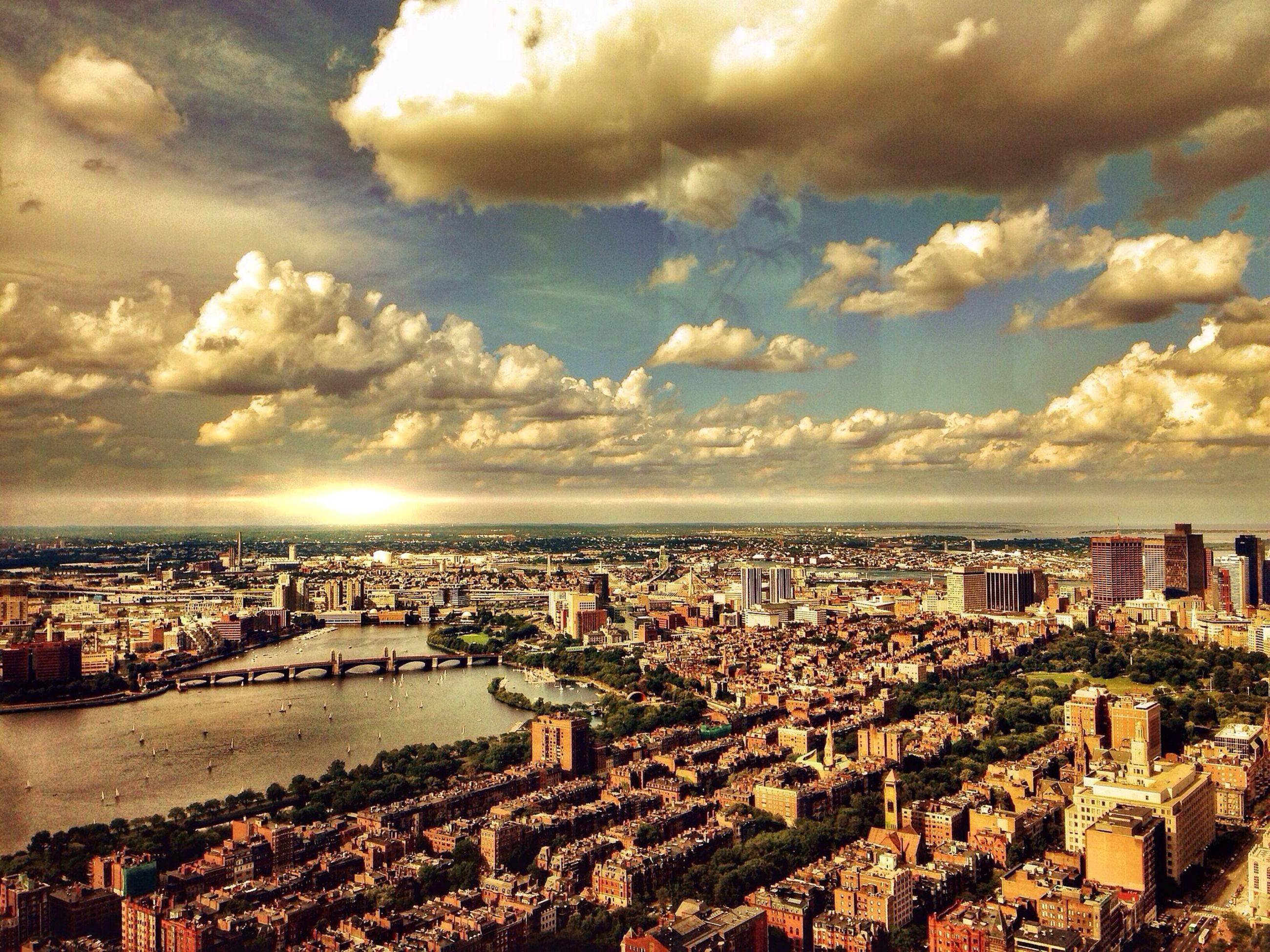 cityscape, architecture, building exterior, built structure, city, sky, cloud - sky, crowded, high angle view, residential district, residential building, sunset, cloudy, cloud, residential structure, river, city life, water, sea, aerial view