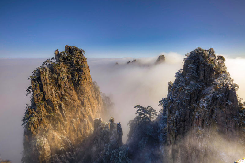 Rock Formations By Cloudscape Against Sky