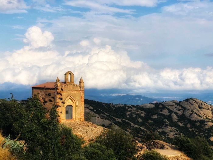 A small chapel on top of one of the cliffs of the Montserrat mountain in the background of clouds Spain. SPAIN Montserrat Chapel Church Nature Beautiful Nature Landscape Clouds Cloudy Sky Built Structure Architecture Cloud - Sky Building Exterior Place Of Worship Building Nature Religion Plant Spirituality Belief No People Tree Mountain Old Outdoors My Best Photo