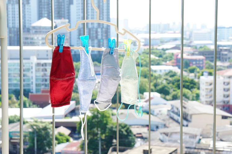 Close-up of clothes drying against window
