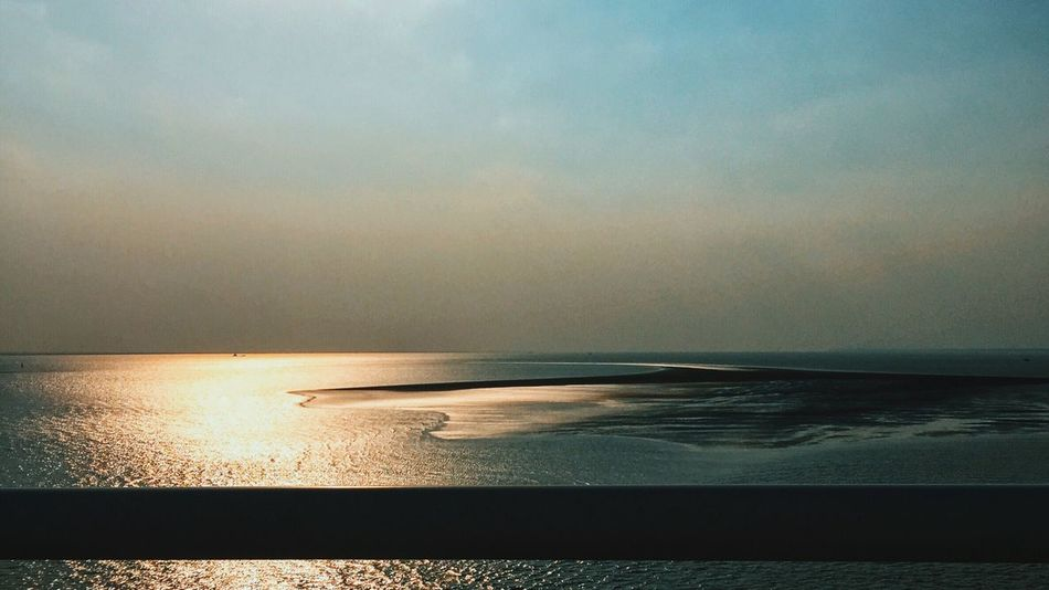 Where the Yangzi river meets with the sea Water Chongming The Yangtse River Horizon Over Water Light Reflections Tides Beauty In Nature Tranquil Scene