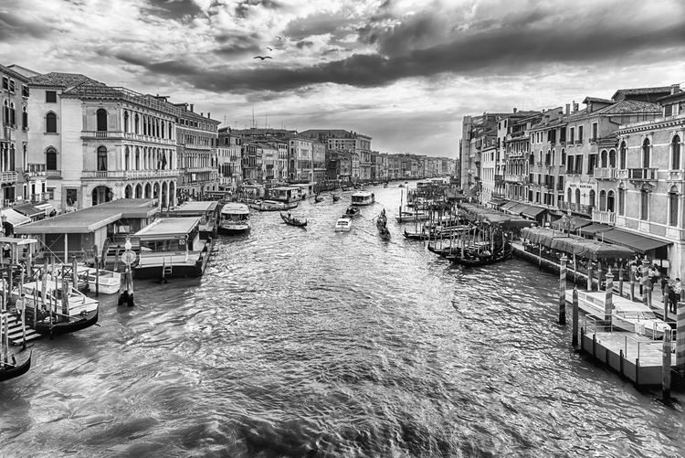 VENICE, ITALY - APRIL 29: Scenic view of the Grand Canal at sunset from the iconic Rialto Bridge, one of the major landmark in Venice, Italy, as seen on April 29, 2018 Architecture Building Building Exterior Built Structure Canal City Cloud - Sky Day Mode Of Transportation Nature Nautical Vessel Outdoors Passenger Craft Residential District Sky Transportation Travel Travel Destinations Water Waterfront