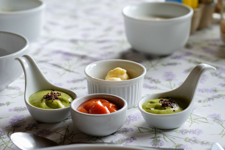 Various savory sauce in spoon on table