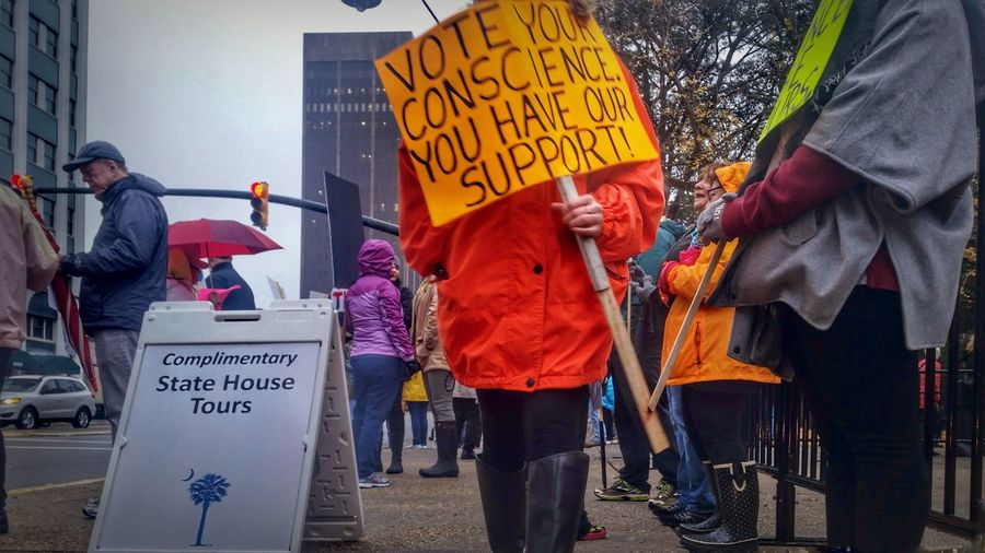 Anti-Trump Rally at the State House 12/19/16 (in HDR, 1/14) -- Hdr_Collection Hdr Edit Protest Protesters Protesting Sign Signs Text Red Adult Adults People Outdoors Day Rainy Day Rainy Photojournalism Participant December Gloomy Gloomy Day Gloomy Weather City Architecture