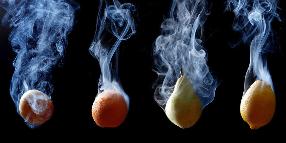 Set of fruits enveloped by smoke on a black background Backgrounds Black Background Close-up First Eyeem Photo Fresh Fruits Healthy Eating Indoors  Jellyfish Landscape Lemon No People Outdoors Peace Studio Shot Swimming