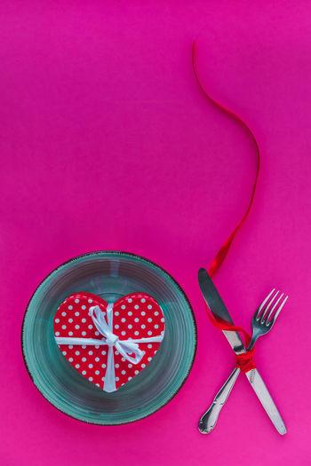 High angle view of pink art on table