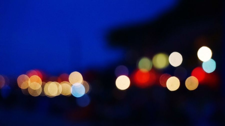 Illuminated Defocused Night Lighting Equipment Multi Colored Blue Fairy Lights Light Effect Spotted Light No People Close-up City Outdoors Abstract Sky