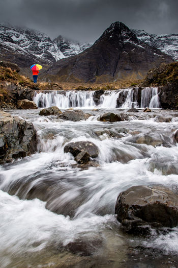 Umbrella on the fairy pools isle of skye scotland Isle Of Skye Fairypools Multicolors  Scotland Portree, Skye Highlands Adventure Mountain River Outdoors Water Rock Motion Power In Nature Flowing Water Waterfall Beauty In Nature