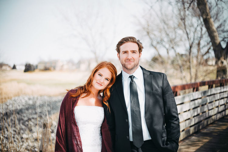 Portrait Of Smiling Couple Standing On Road
