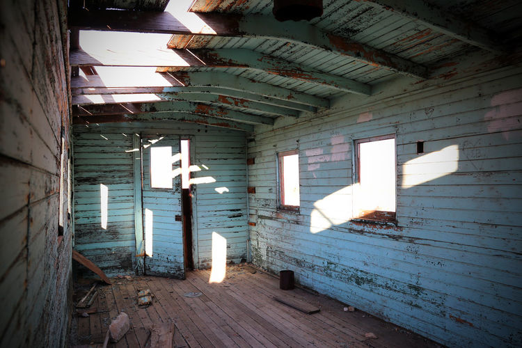 Train Car Wood Abandoned Architecture Bad Condition Built Structure Ceiling Damaged Day Destruction Dirty Empty Ghost Town Indoors  No People Old-fashioned Rotting Rubble Run-down Spooky Train Carriage Weathered Window Wood - Material