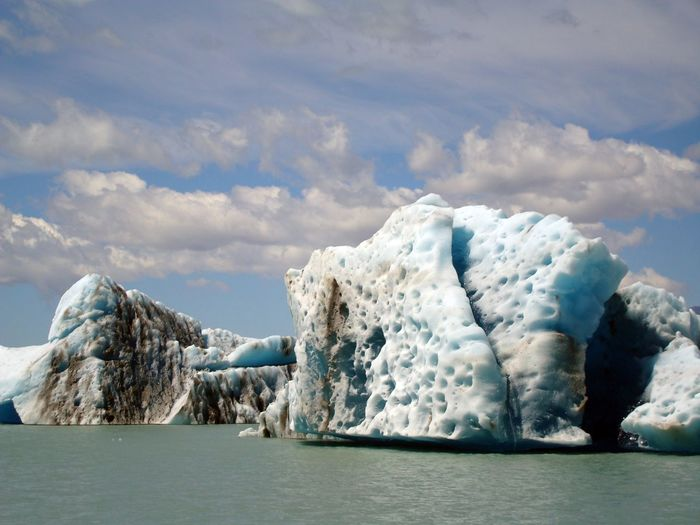 Scenic View Of Glaciers Floating On Sea