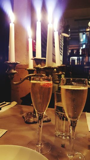 in this quick snap of my bubbles i found my candles doing an imitation of the 21st century fox searchlights 😊 Hanging Out Taking Photos Enjoying Life Prosecco Candlelight Candles Light Up Your Life EyeEm Gallery Date Dinner Date Fancy Torches Searchlight
