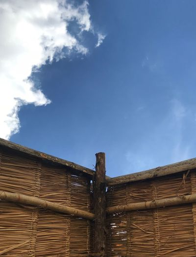 Thatched roof and blue sky Blue Thatched Roof Roof Sky Cloud - Sky Architecture Nature Day Built Structure No People Wood - Material
