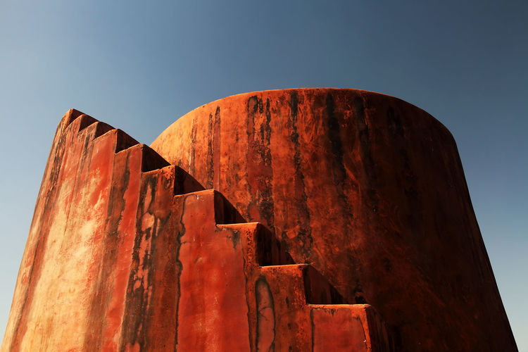 Low angle view of steps against clear sky at jaigarh fort on sunny day