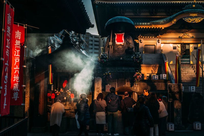 Architecture Building Exterior Built Structure City Large Group Of People Men Night Outdoors People Praying Real People Shadow Smoke - Physical Structure Sugamo,Tokyo Temple Temple - Building Worshippers