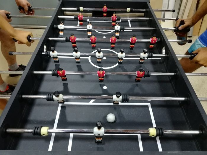 High angle view of friends playing foosball