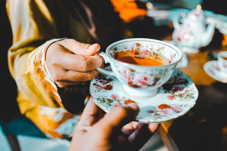 Serving High Tea Close-up Cup Drink Floral Pattern Food And Drink Freshness Hand Holding Hot Drink Lifestyles Refreshment Selective Focus Togetherness Tea Cup The Still Life Photographer - 2018 EyeEm Awards