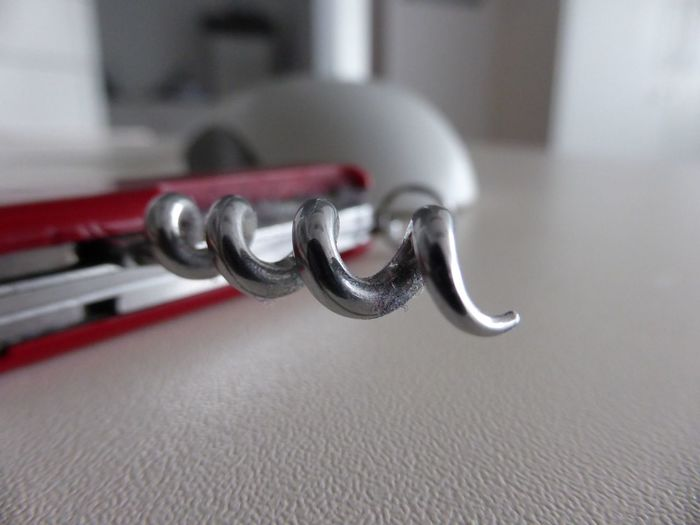 Close-Up Of Corkscrew On Table