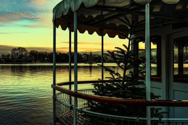 christmas tree Binnenalster Morning Light Pleasure Boat Terminal christmas tree Water Sunset Sky Architecture Nature No People Built Structure River Cloud - Sky Outdoors Tree Railing Orange Color Beauty In Nature Plant Scenics - Nature Reflection Tranquility