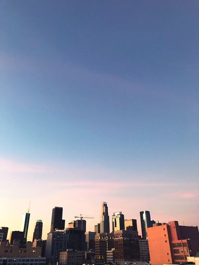 View Of Cityscape Against Sky During Sunset