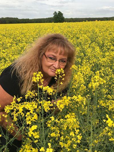 Portrait of woman on mustard field