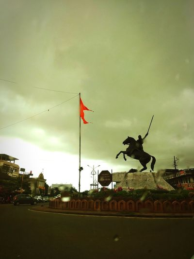 Statue of great Queen Tararani Bhosale Rain Rainy Days Unique Statue One Of Its Kind Architectural Wonders World Famous Sculpture Warrior Indian Queen Warrior Flag Road Historical Monuments Maratha Queen Statue Statue In The City Queen