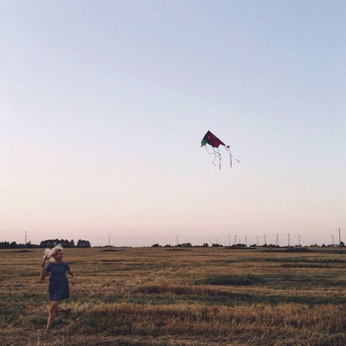 Field Real People Rural Scene Flying Farm Clear Sky Lifestyles Agriculture Nature Men Outdoors Leisure Activity Grass Landscape Sky Growth One Person Kite Scenics Day
