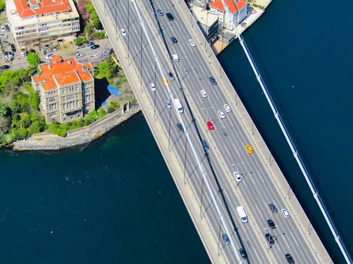 High angle view of cars moving on bridge over sea during sunny day
