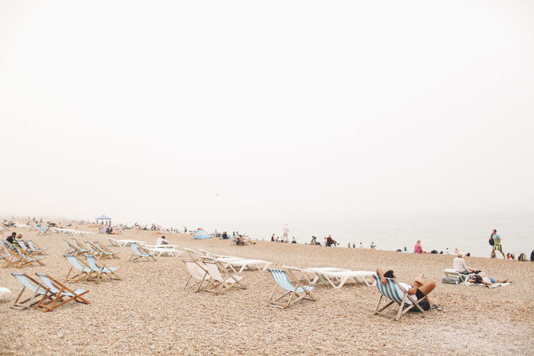 Beach Beach Chairs Beauty In Nature Brighton Chairs Day Fog Foggy Landscape Lifestyles Mammal Nature Outdoors Relax Relaxing Sea Seaside Sky Summer Summertime Tranquil Scene Tranquility Vacation Vacation Time Sommergefühle Adventures In The City